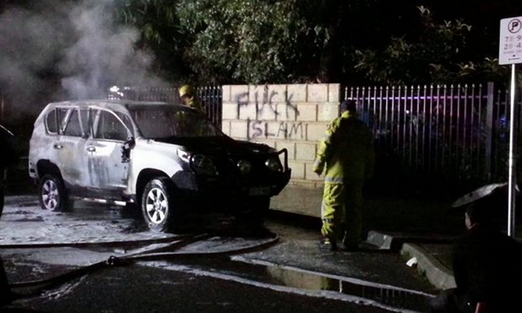 A car was burnt and anti-Islamic graffiti sprayed on a fence outside a Perth mosque on Tuesday night.