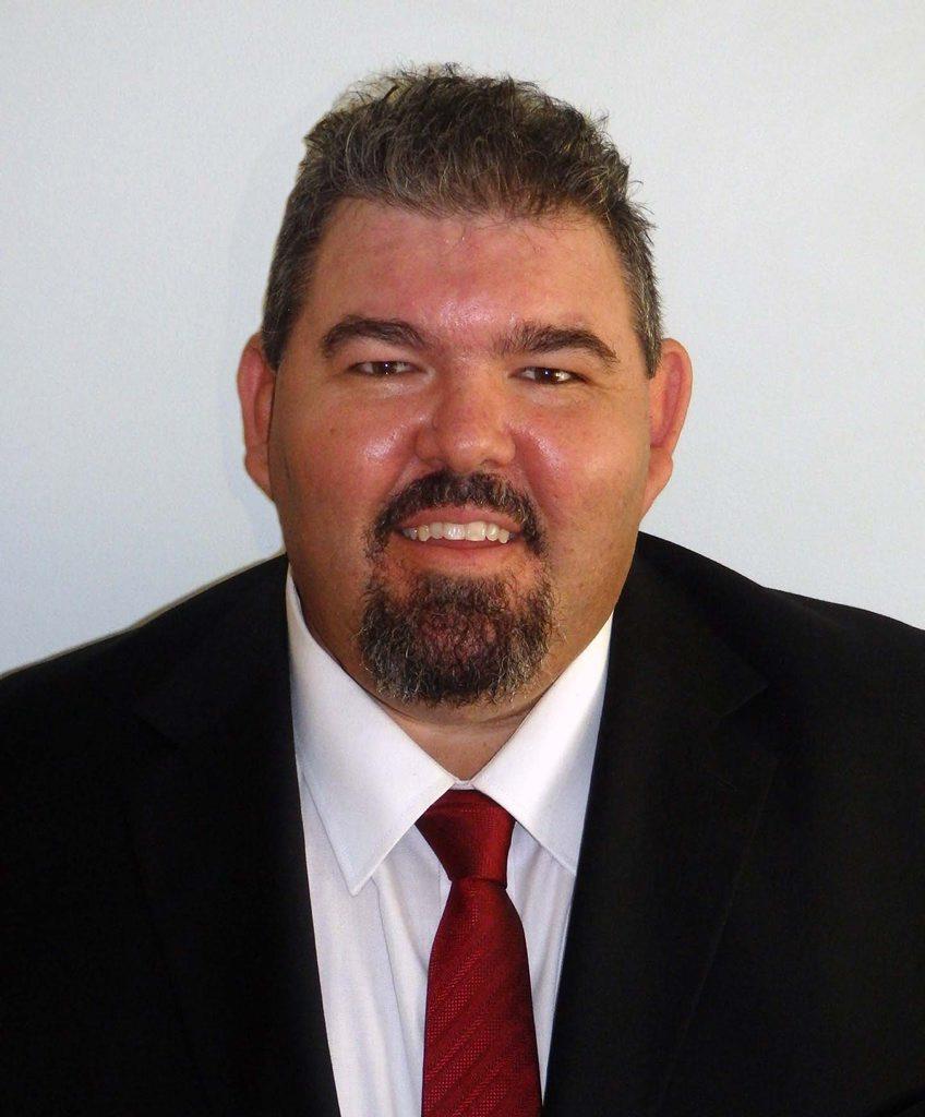 STANDING: Glenn Lazaru Team candidate for Dawson Michael Hall. Photo contributed.