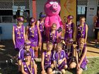 EFFORT: Whitsunday Netball's youngest players in the Moddies Division with carnival mascot Crackles.