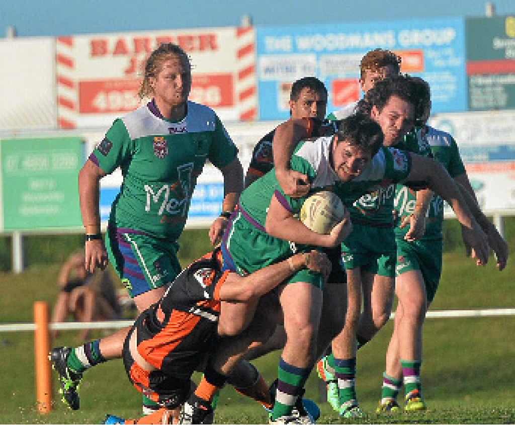 HARD RUN: Whitsunday Brahmans' Dane Vandanegl busts through a tackle. Photo: Madolyn Peters / Daily Mercury