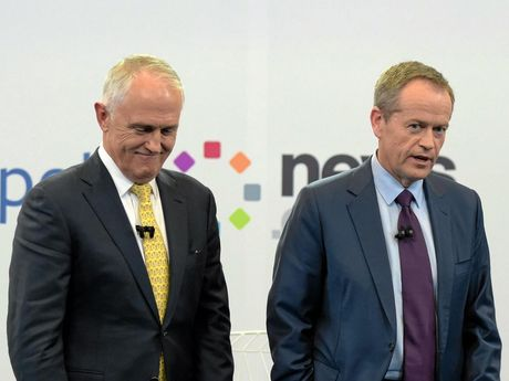 Australian Prime Minister Malcolm Turnbull and Australian Opposition Leader Bill Shorten react at the end of a leaders debate hosted by Facebook Australia and News.com.au in Sydney, Friday, June 17, 2016.  (AAP Image/Lukas Coch/POOL) NO ARCHIVING