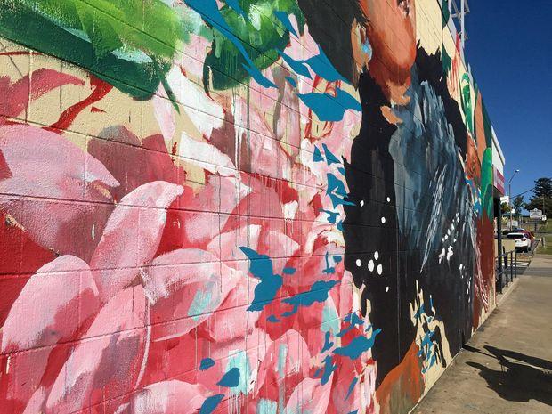 Paint drips run down the mural.