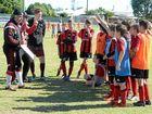 GAME ON: AC Milan football academy's Andrea Icardi teaches Bundaberg juniors.