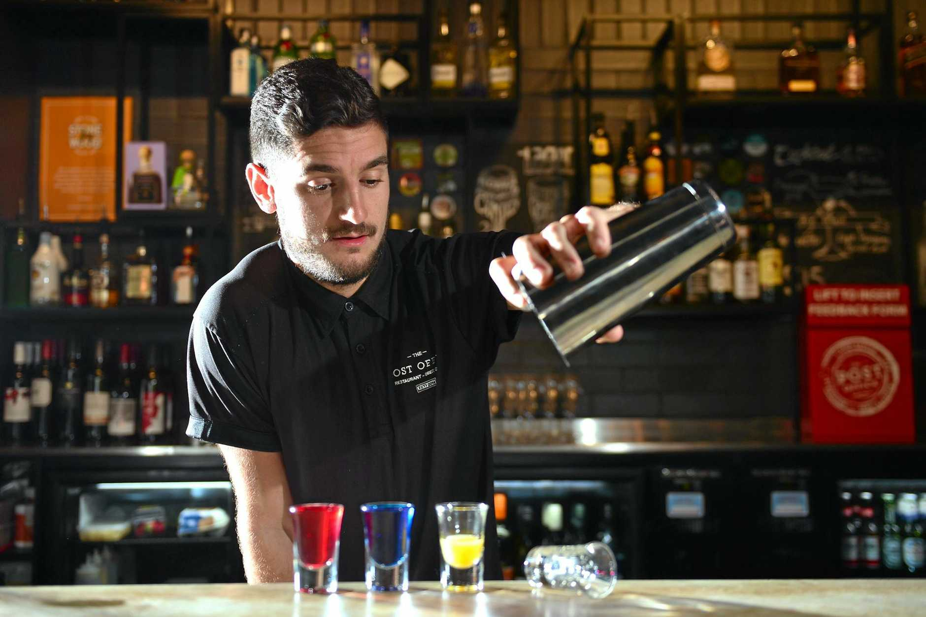 New liquor and lockout laws come into affect tomorrow meaning bars have to stop serving shots after midnight. Barman at The Post Office bar in Maroochydore Jason  Roper.  Photo: John McCutcheon / Sunshine Coast Daily