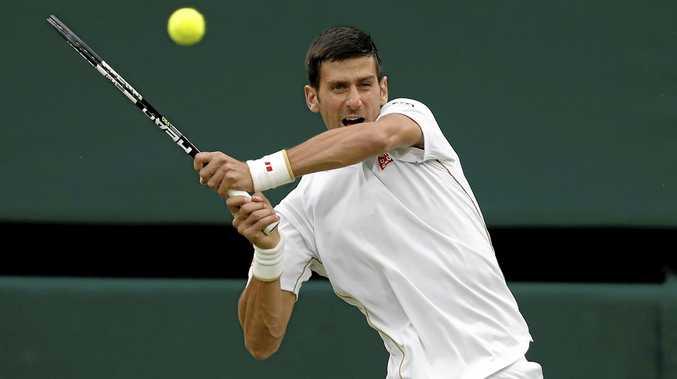 STREAK CONTINUES: Novak Djokovic of Serbia returns to Frenchman Adrian Mannarino in the second round at Wimbledon.