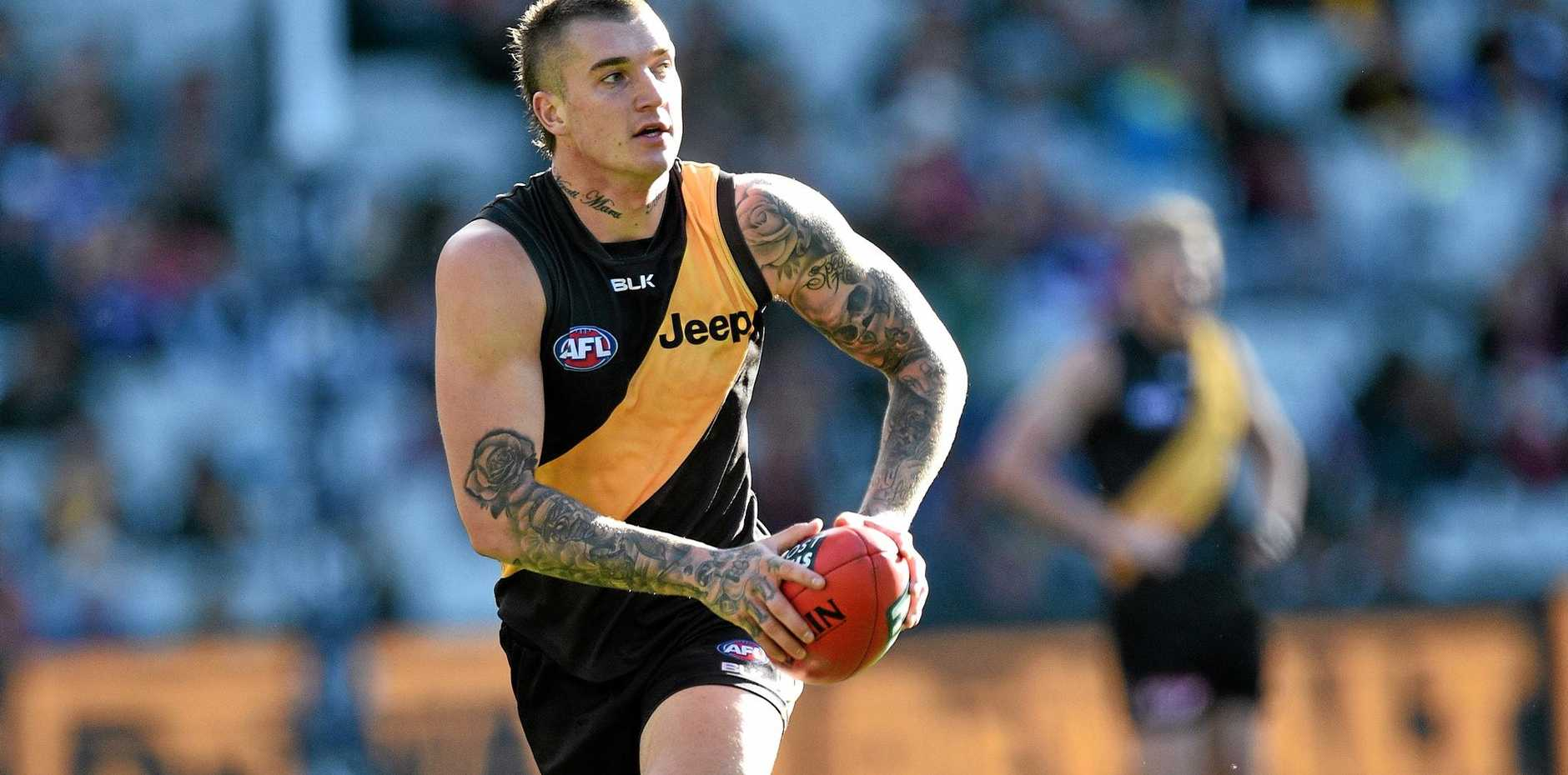 FLAWED GENIUS: Dustin Martin has been great on the field for the Tigers but less than exemplary off it.