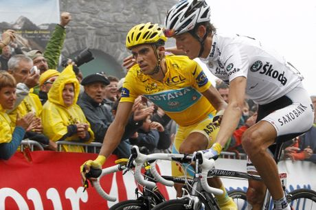 Stage winner Andy Schleck of Luxembourg (right) and Alberto Contador of Spain, wearing the overall leader's yellow jersey, crossing the finish line on Tourmalet Pass in 2010. Contador was later stripped of his 2010 Tour de France title.