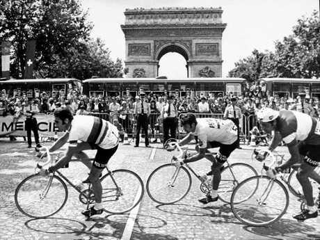 Belgian Eddie Merckx (left) leads Frenchmen Bernard Thevenet and Regis Ovion past the Arc de Triomphe in Paris during the last lap of the Tour de France in 1975.