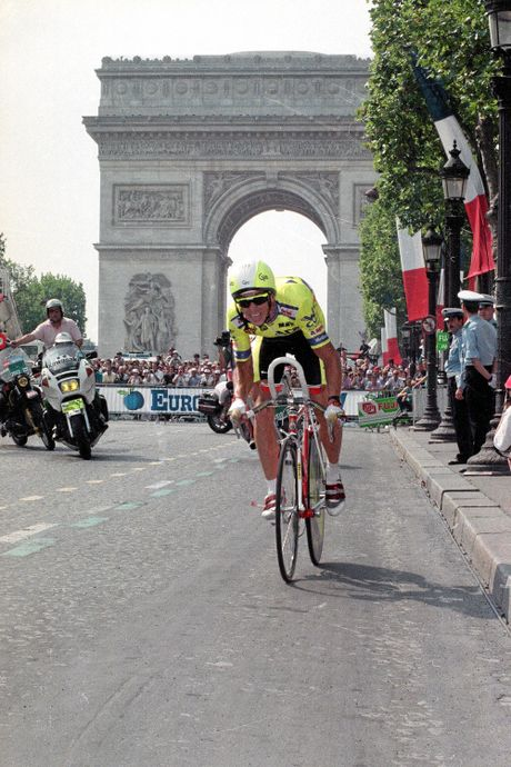 Greg LeMond, of the United States, rides down the Champs-Elysees, with the Arc de Triomphe in background, on his way to winning the 1989 Tour de France.