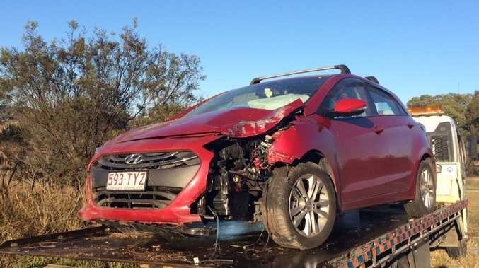 A woman escaped injury when she swerved to miss a kangaroo near Warwick this morning.