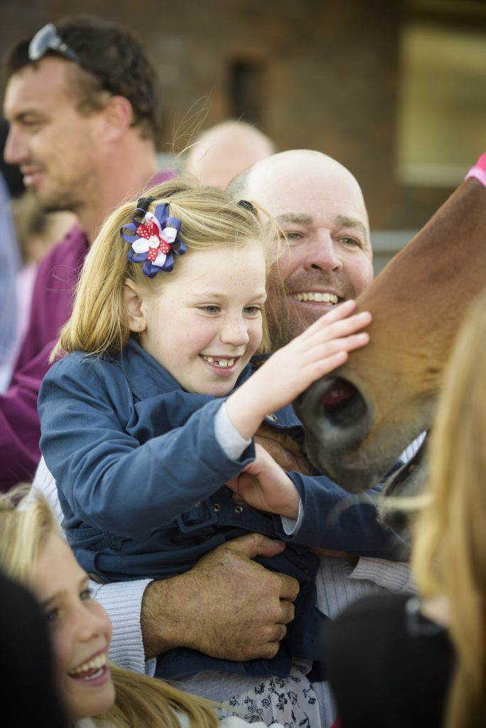 Part owner of Nautile Gary Powell lifts his daughter Amber up to give his Maclean Cup winner Nautile. Photo Adam Hourigan / The Daily Examiner