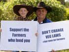 FIGHTING FOR FARMERS: Allan Lucas and his son Jake, 7 join in the fair laws for farmers protest held at Kershaw Gardens by yesterday.