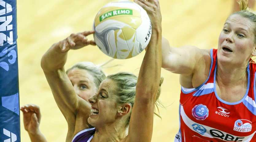 Firebirds captain Laura Geitz takes a rebound against the NSW Swiftrs in last year's frand Final between the Queensland Firebirds and NSW Swifts in Brisbane, Sunday, June 21, 2015. (AAP Image/Glenn Hunt) NO ARCHIVING, EDITORIAL USE ONLY