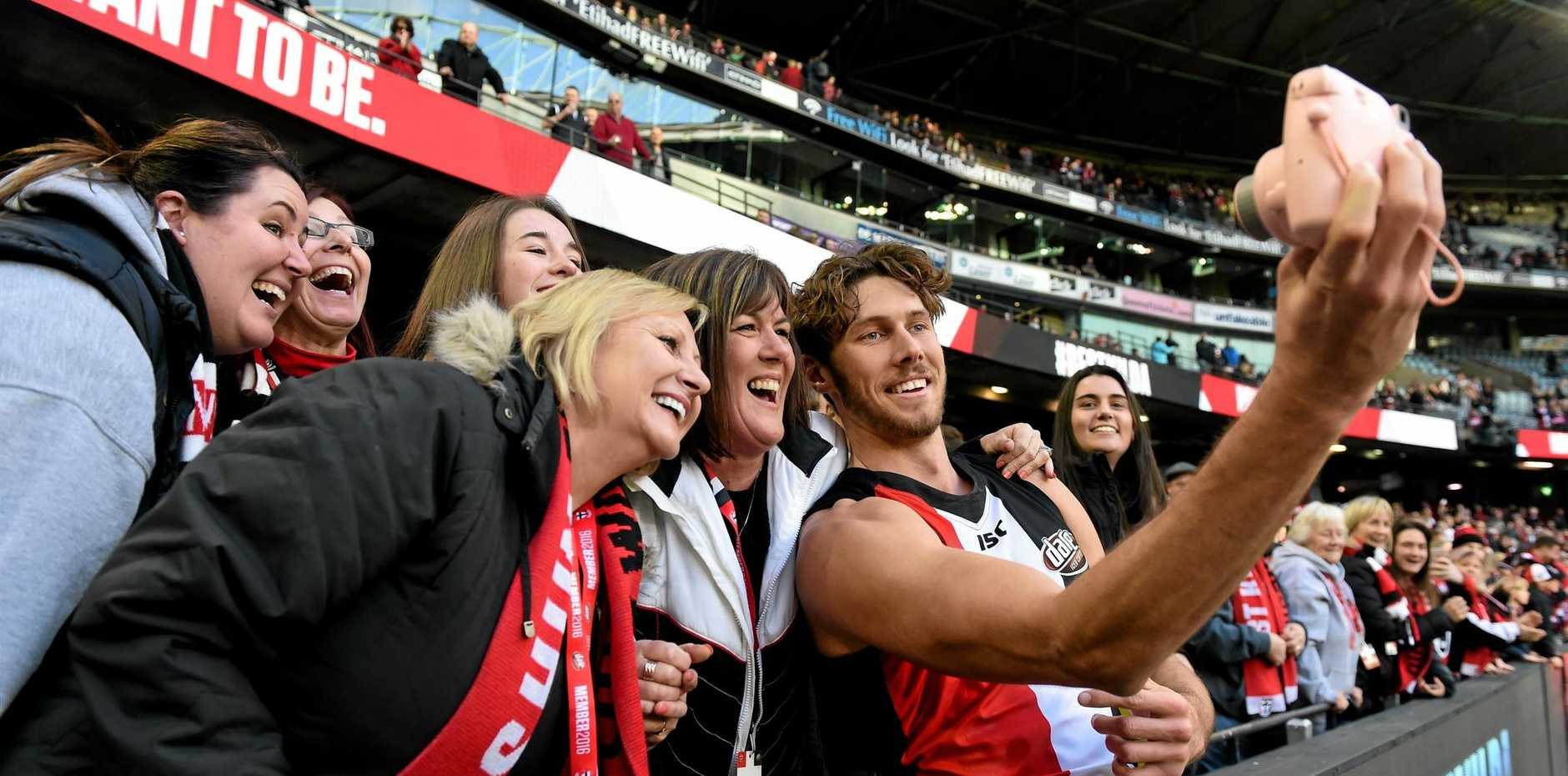 SEEKING CONSISTENCY: Tom Hickey of the Saints takes a selfie with fans as he celebrates winning their Round 12 AFL match against Carlton at Etihad Stadium.