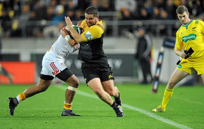 SEEKING INTENSITY: Dane Coles of the Hurricanes tries to hold off a Chiefs defender.