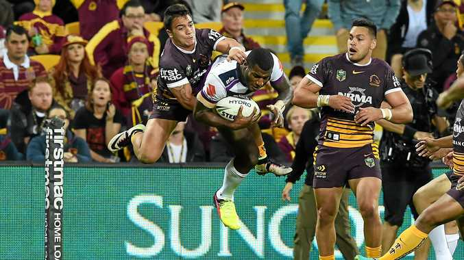 DANGER MAN: Kodi Nikorima (left) of the Brisbane Broncos tries unsuccessfully to stop Suliasi Vunivalu of the Melbourne Storm from scoring a try during their round 17 clash at Suncorp Stadium.
