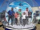 A giant snow globe at the festival keeps people entertainment at the Snowflakes in Stanthorpe festival.
