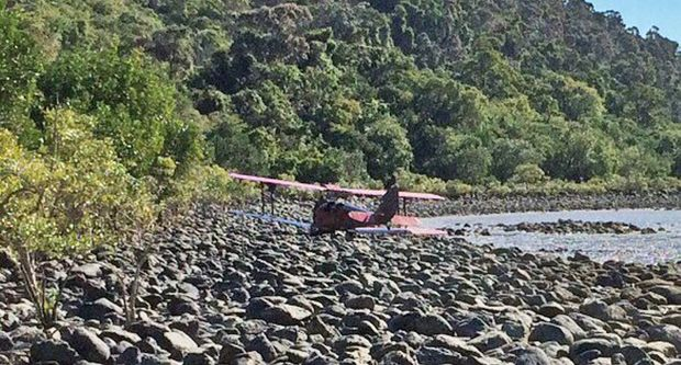 SAFE LANDING: The Tiger Moth plane made an emergency landing to the right of Funnel Bay after encountering an unknown issue this afternoon. Photo contributed.