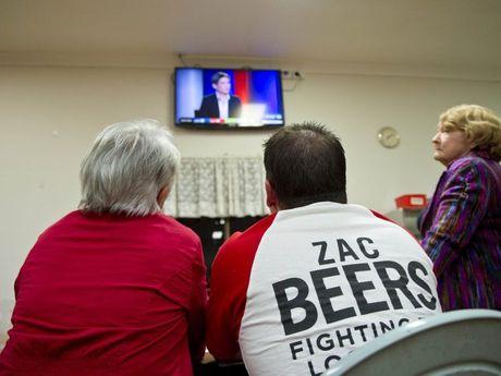 Zac Beers supporters' Shelly Holzheimer mayor Matt Burnett have their eyes firmly focused on the TV screen.