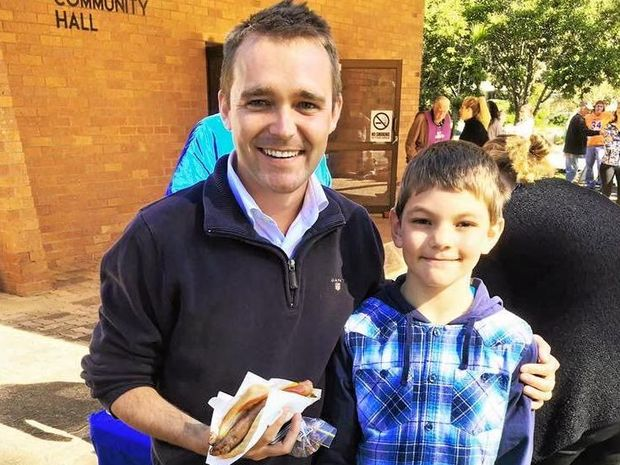 LONGMAN VOTES: LNP candidate Wyatt Roy enjoying the sausage sizzle with a future voter on Election Day on Saturday.