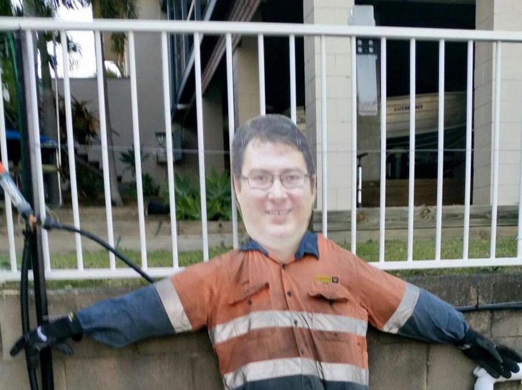 VANDAL: A cut out of George Christensen's face has been used for a scarecrow. Mr Christensen posted this picture to Facebook this morning. Photo contributed.