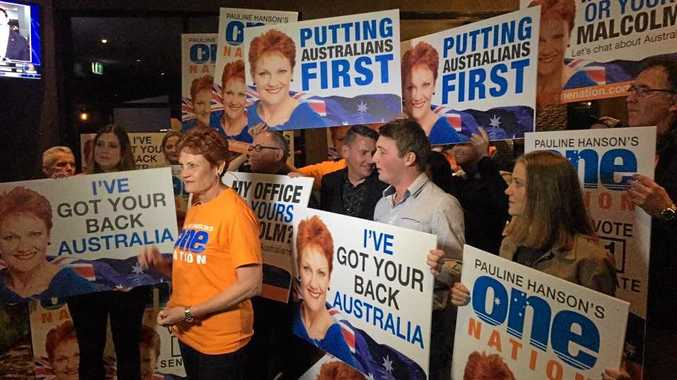 SURGE: A groundswell of support has lifted Pauline Hanson, pictured with supporters on Saturday night, back into political office as a Queensland Senator.