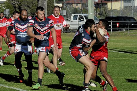 South Grafton's Tom McGrady wraps up Roosters' centre Jay Melrose in a ball and all tackle in the South Grafton Rebels defeat of the Nambucca Heads Roosters at McKittrick Park.