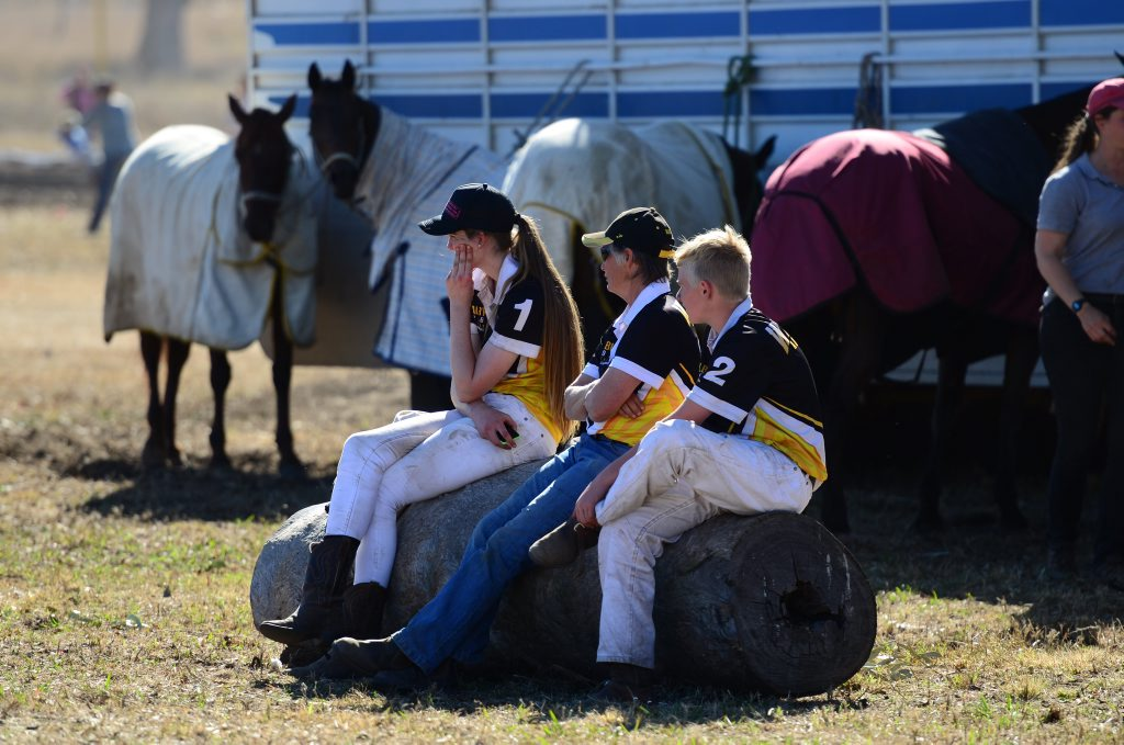 Players from the Western Australian junior team watch the seniors game at Tansey's annual polocrosse carnival on Sunday, July 3.