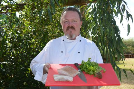 REGIONAL FLAVOURS: Jason Ford prepares the region's famous pork belly wrap, ahead of the South Bank event.