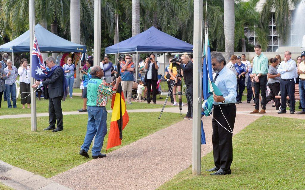 Mayor Greg Williamson, Yuwibara Elder Mr George Tonga and Torres Strait Elder Mr Albert Ramsamy raising flags for the start of NAIDOC week.