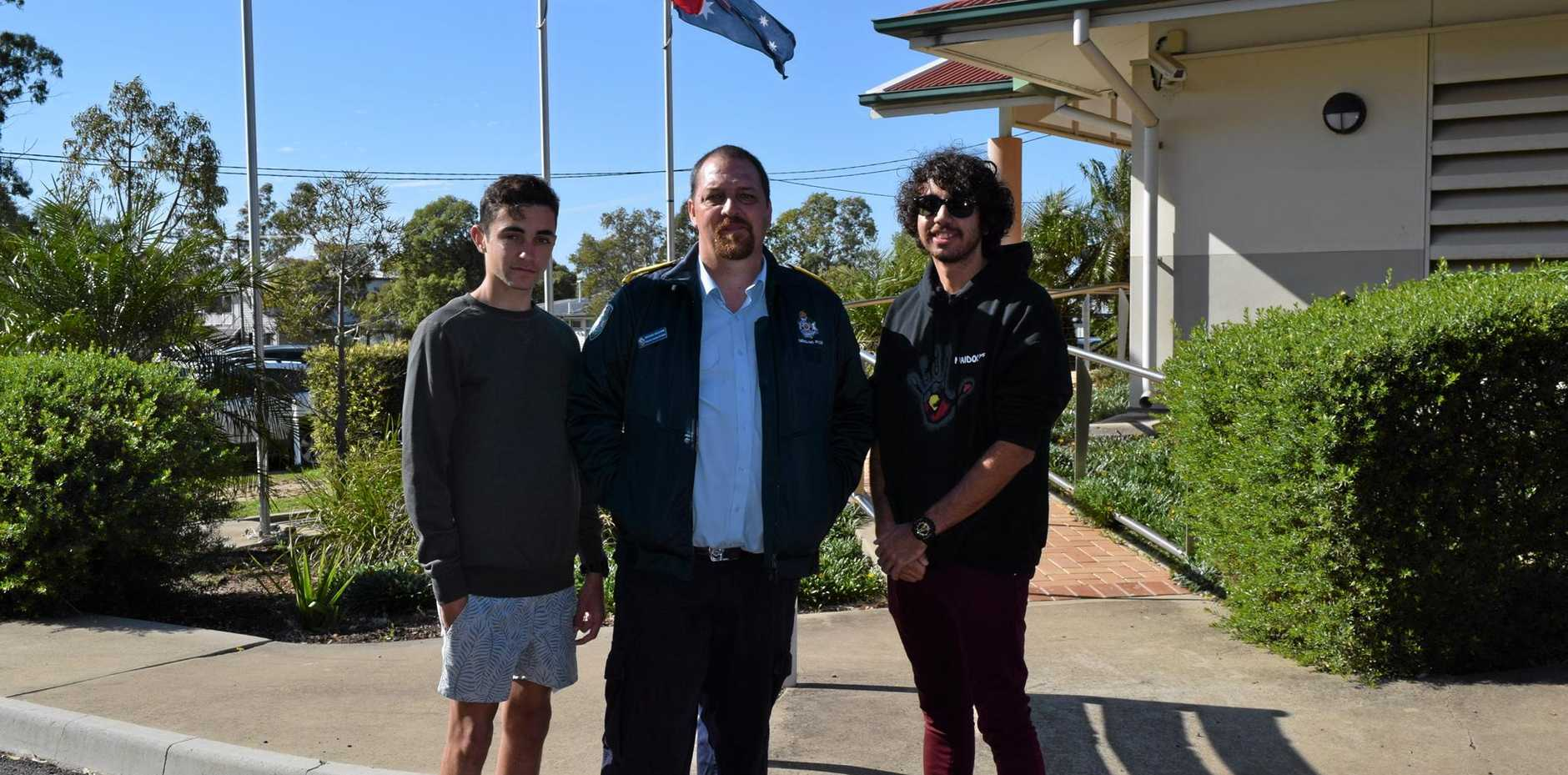 Tallis Landers, Michael McGuane and Lane Brookes attend the official flag raising ceremony as NAIDOC week begins.