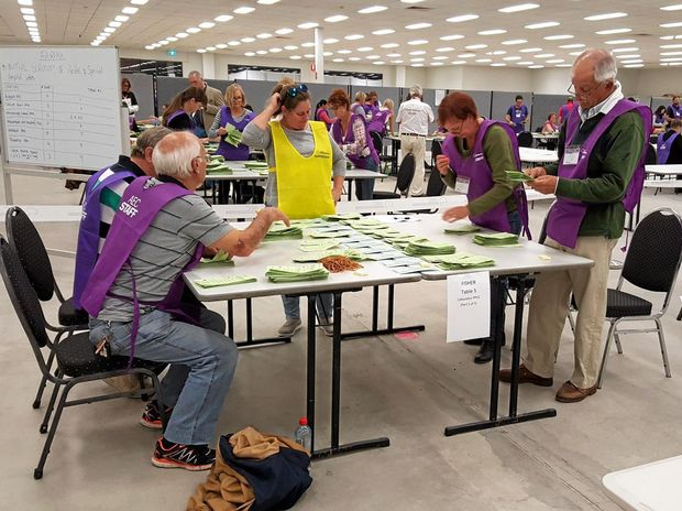 COUNT: Pre-poll votes for Fisher and Fairfax being counted in Maroochydore.