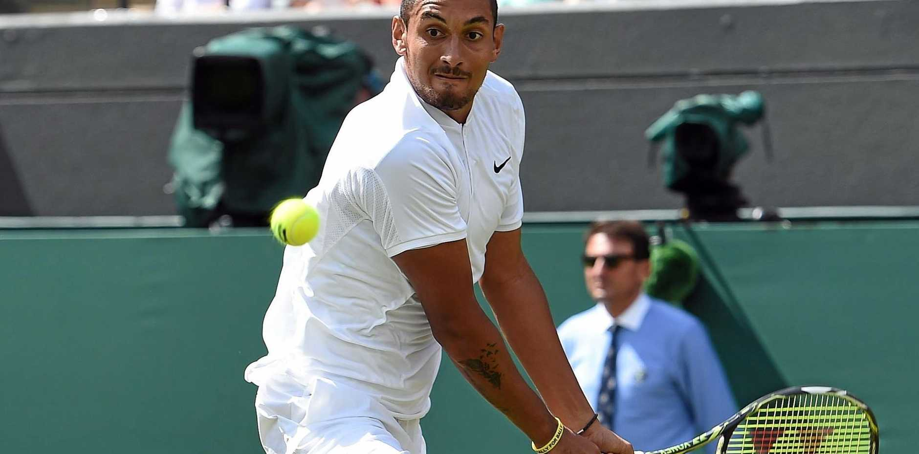 MARCHING ON: Nick Kyrgios of Australia returns to Feliciano Lopez of Spain in their third-round match during the Wimbledon Championships at the All England Lawn Tennis Club in London.