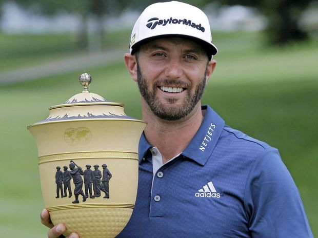 GOOD FORM: Dustin Johnson holds up the trophy after winning the Bridgestone Invitational golf tournament at Firestone Country Club.
