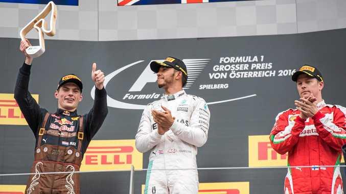 RACE CONTROVERSY: British driver Lewis Hamilton of Mercedes (centre), Dutchman Max Verstappen of Red Bull Racing (left) and Finnish driver Kimi Raikkonen of Scuderia Ferrari celebrate on the podium after the 2016 Grand Prix of Austria in Spielberg.