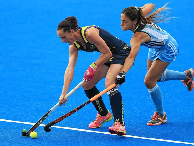 TEAM LEADER: Australia's Madonna Blyth and Argentina's Carla Dupuy compete for the ball during their match in the the women's Champions Trophy in London last month.