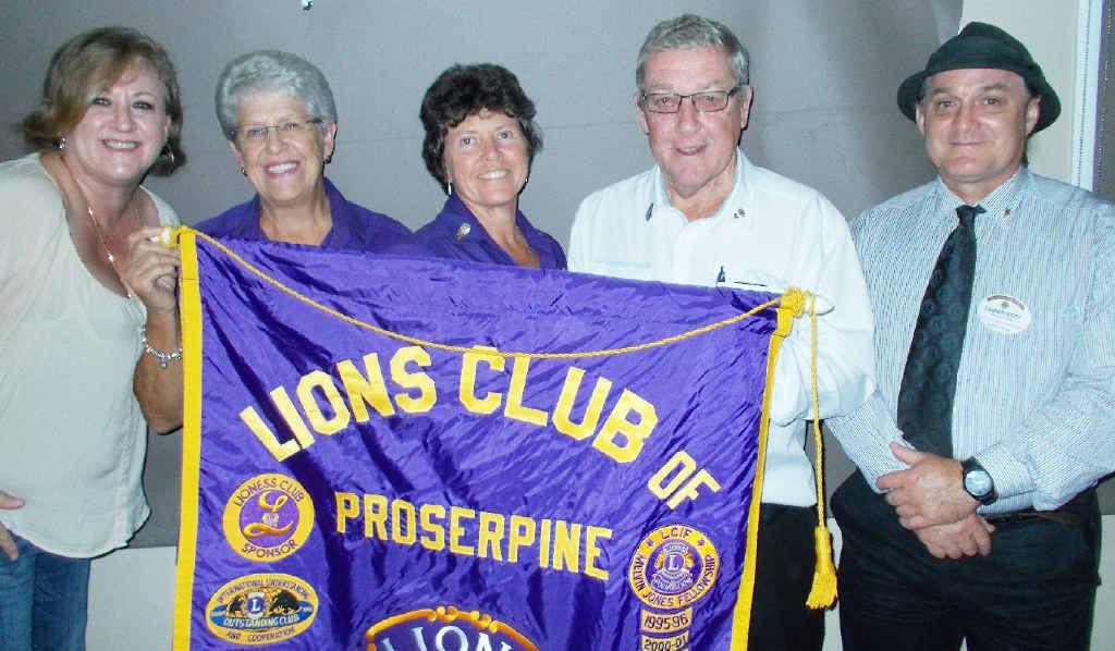 HAND OVER: Jo-Ann Kielly, Sandra Watson, Sue Dair, Tim McBride and Damien Mott at the Proserpine Lions changeover dinner.