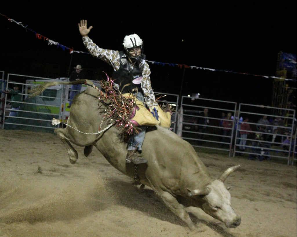 WILD RIDE: Josh Beretta rides Moves Like Jagger. INSET: More action from the Bullarama rodeo.