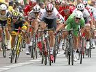 CLOSE ONE: Britain's Mark Cavendish (right, wearing the best sprinter's green jersey), races towards the finish line to win ahead of Germany's Andre Greipel (centre in white) and France's Brian Coquard (left) during the third stage of the Tour de France over 223.5km from Granville to Angers.