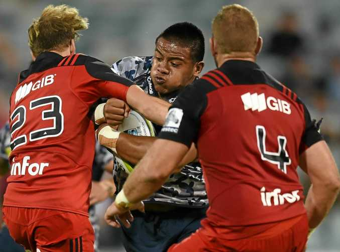 PACKING A PUNCH: Allan Alaalatoa of the Brumbies is tackled by the Crusaders defence in Round 9 of the Super Rugby at GIO Stadium in Canberra.