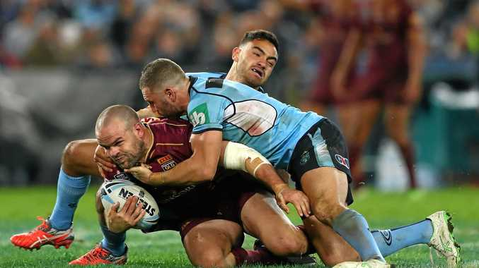 IN DOUBT: Queensland forward Nate Myles is tackled by the New South Wales defence.