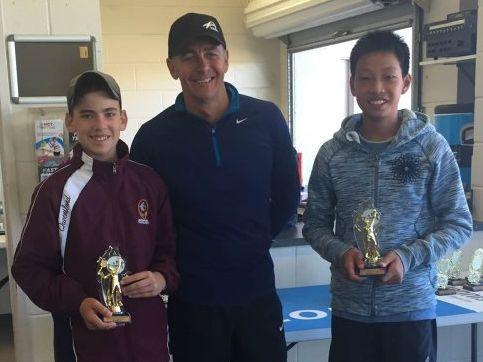 14 singles boys winner Casey Hoole (left) with runner-up Nan Hsun Lin and Top Tennis Academy head coach Leon Glinster.