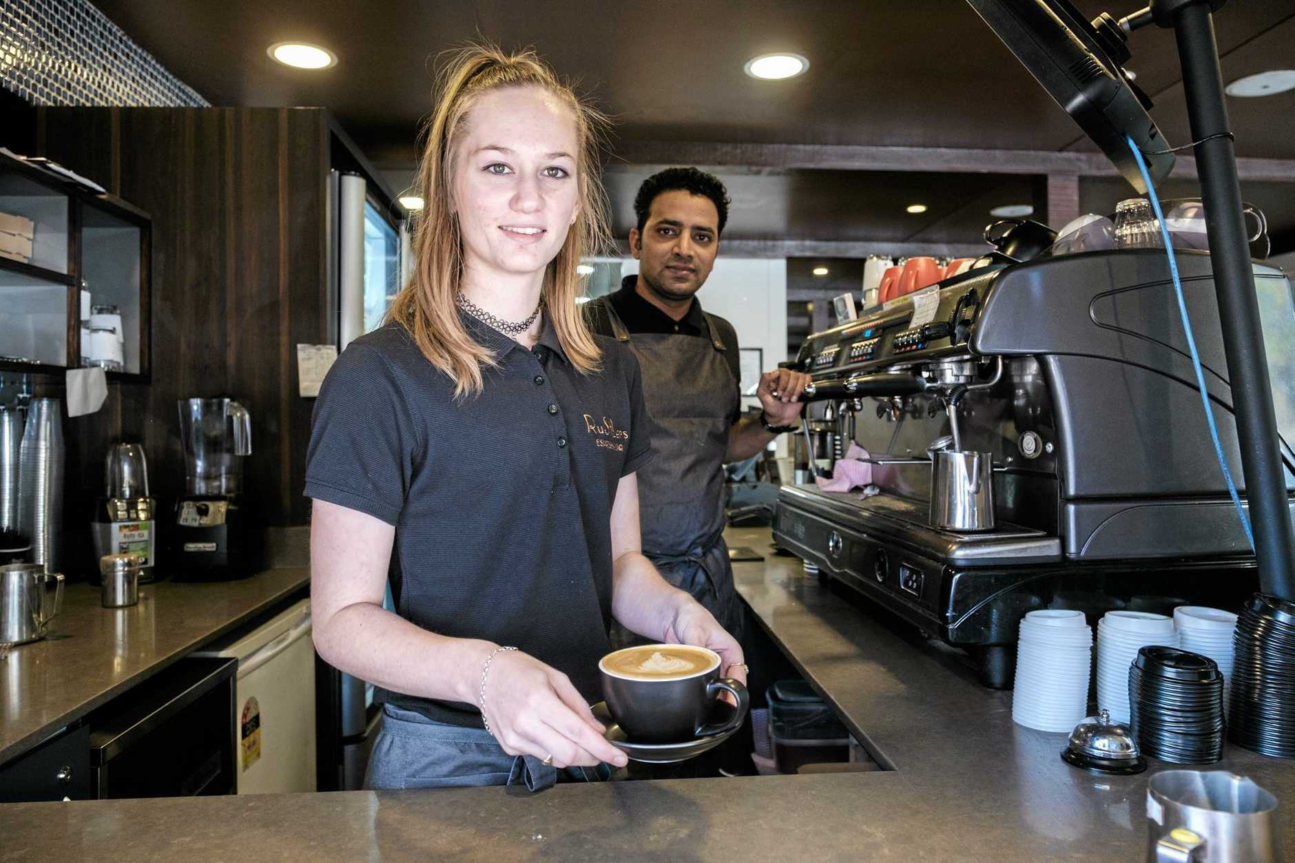 Barista Allie Strathearn and manager Jay Kumar at the newly re-branded Rustlers Espresso Bar on Chinchilla's Bell St.