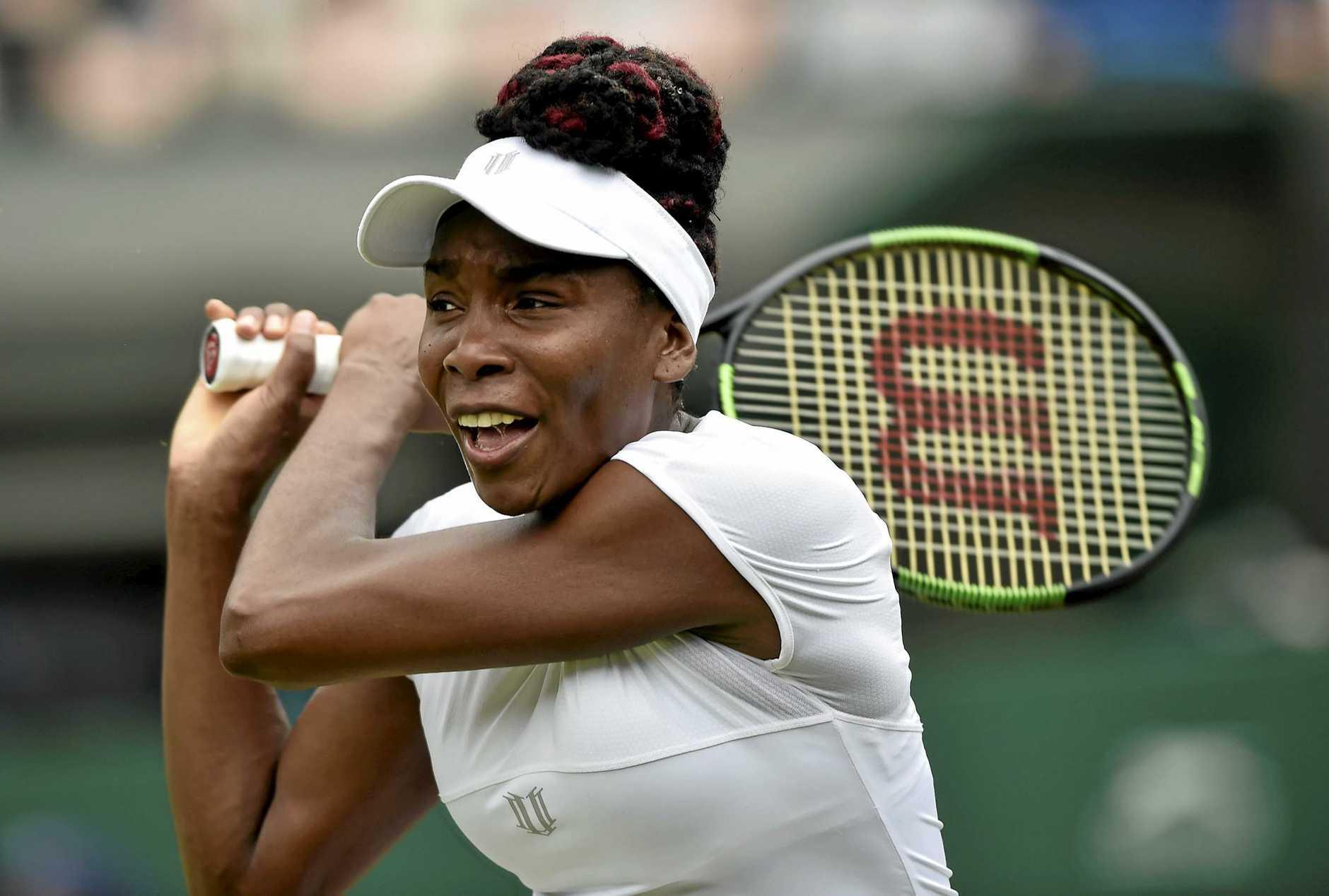 Venus Williams plays Yaroslava Shvedova in their quarter final match at the All England Lawn Tennis Club in London.