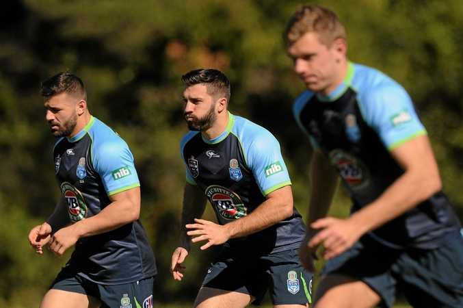 Centre of attention ... James Tedesco during a Blues training run at Coffs Harbour today.