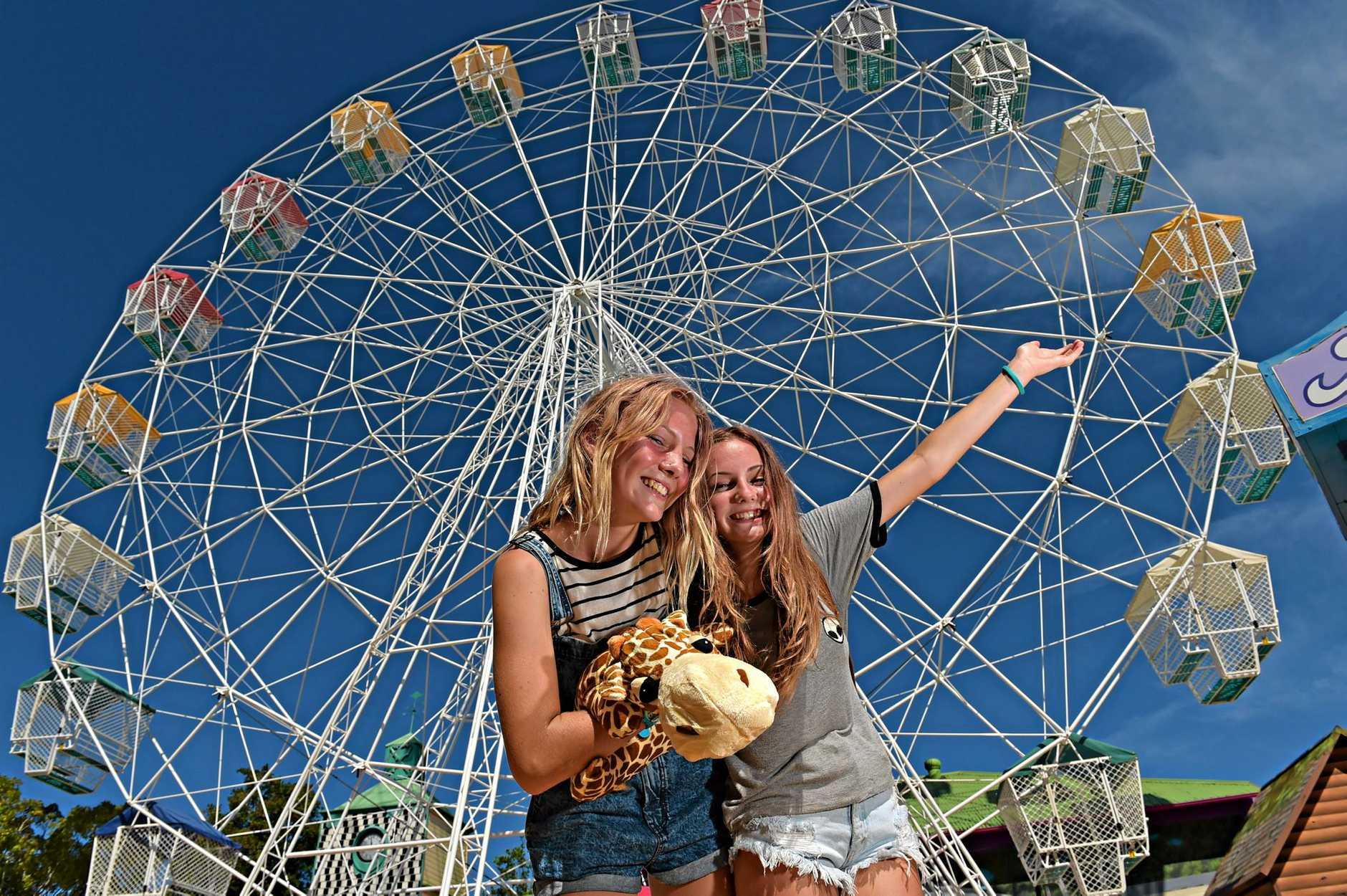 Izzy Denby,14, and Isabella Palmer,14, can't wait to ride the refurbished ferris wheel at Aussie World. Photo: Warren Lynam / Sunshine Coast Daily
