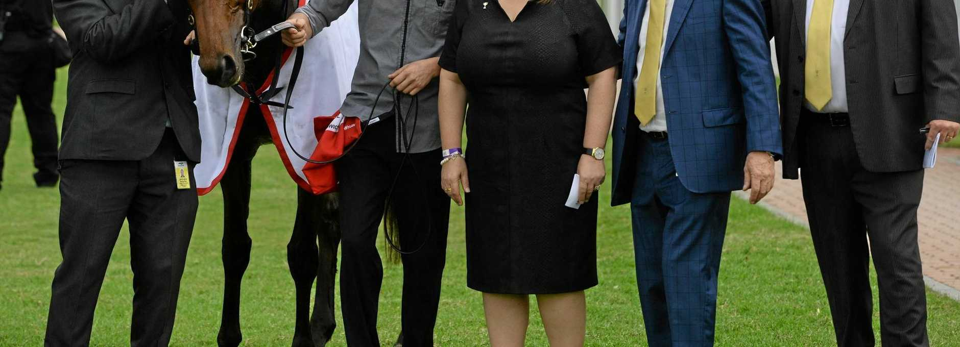RACING'S FRIEND: Racing Minister Grace Grace (centre) at the Ipswich Cup last month. Ms Grace is backing Ipswich Turf Club's redevelopment plans.