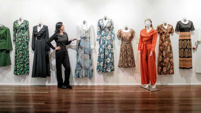 Exhibition curator Lesley Apps looks over some of the dresses as part of her