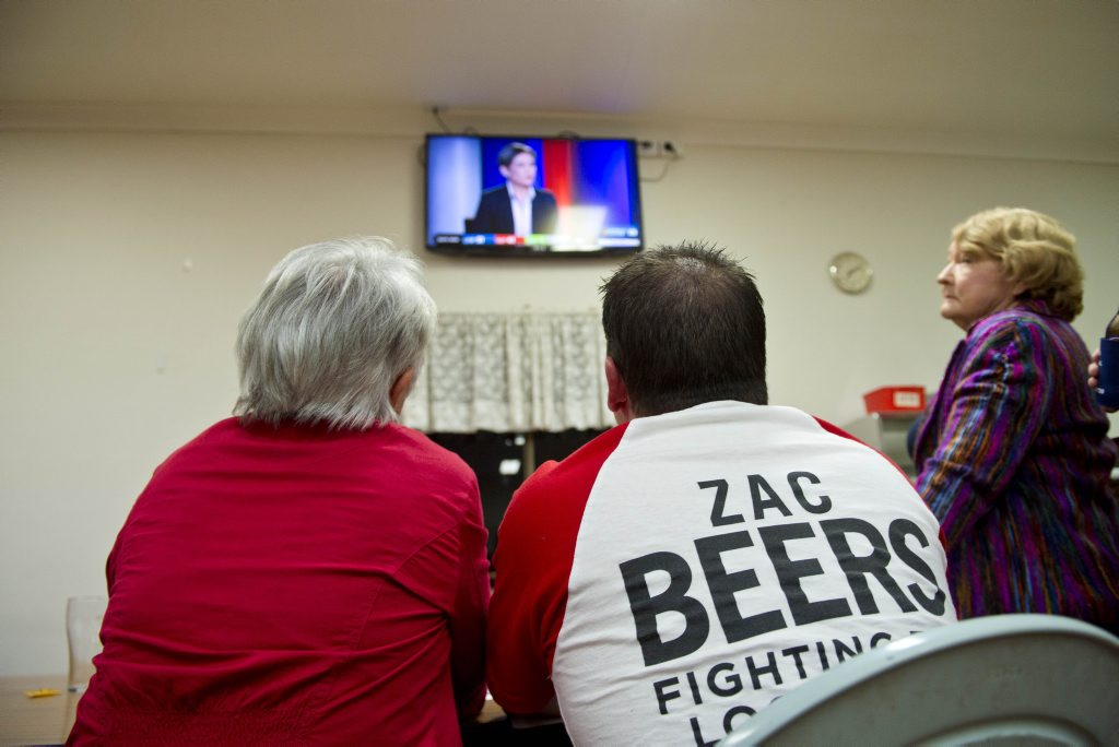 Zac Beers supporters' Shelly Holzheimer mayor Matt Burnett have their eyes firmly focused on the TV screen.