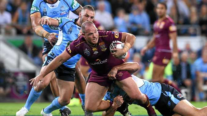 CONSISTENT PERFORMER: Matt Scott of the Maroons is tackled during game two of the State of Origin series.